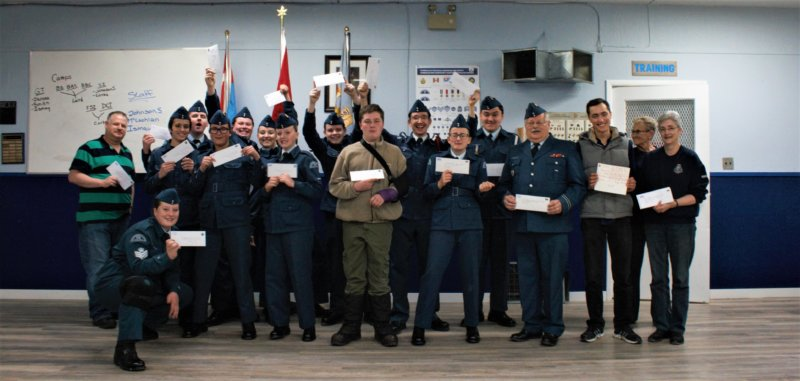 Members of the 581 Squadron holding their letters to be sent to Canadian Armed Forces members serving away from home.  Photo credit: Matthew Mussio